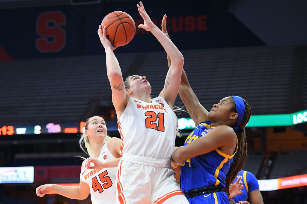 Jan 28, 2021; Syracuse, New York, USA; Syracuse Orange guard Emily Engstler (21) shoots the ball as Pittsburgh Panthers forward Cynthia Ezeja (right) defends during the first half at the Carrier Dome. Mandatory Credit: Rich Barnes-USA TODAY Sports
