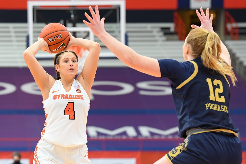 Jan 31, 2021; Syracuse, New York, USA; Syracuse Orange guard Tiana Mangakahia (4) controls the ball against the defense of Notre Dame Fighting Irish guard Abby Prohaska (12) during the first half at the Carrier Dome. Mandatory Credit: Rich Barnes-USA TODAY Sports