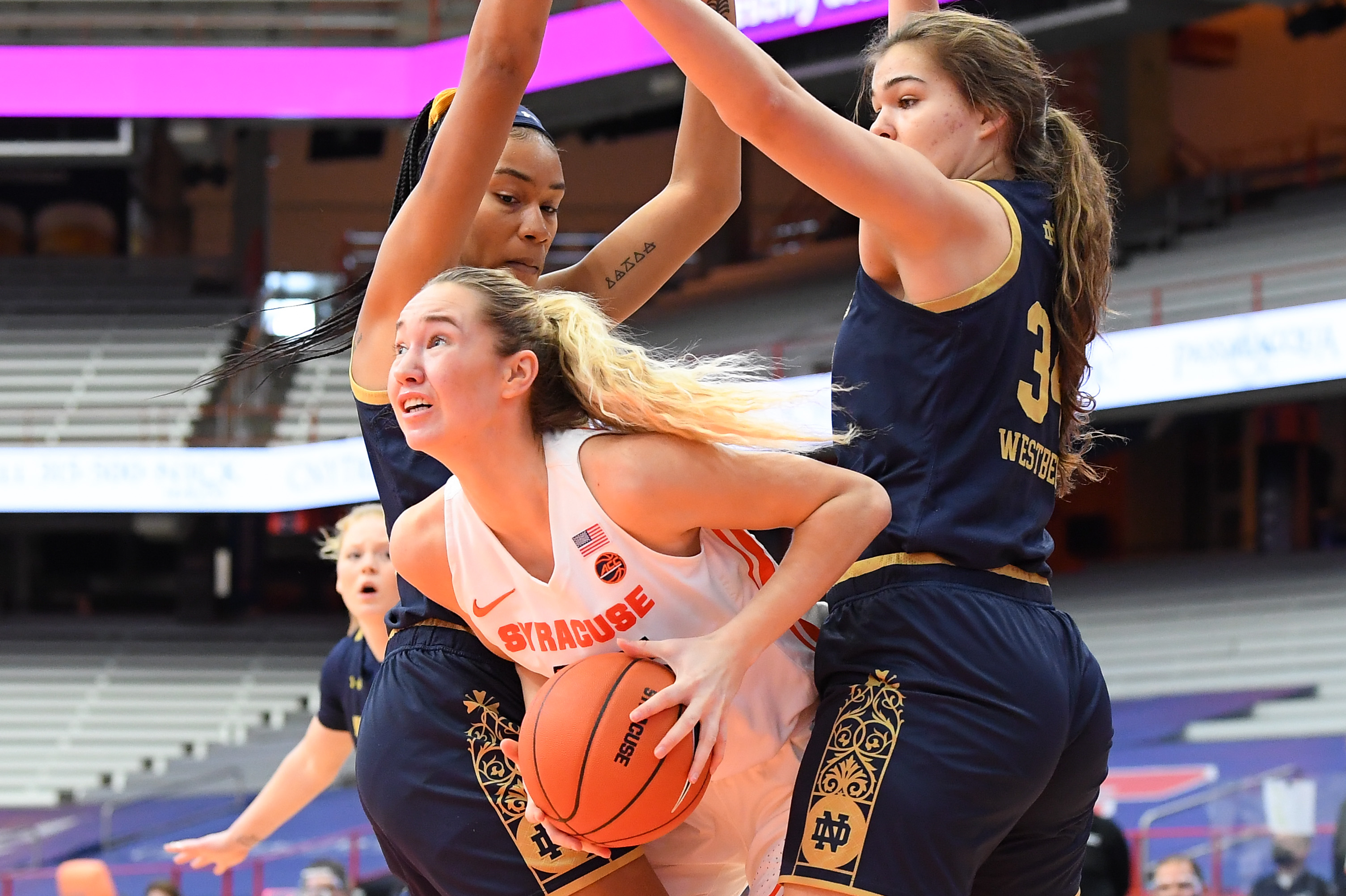 Jan 31, 2021; Syracuse, New York, USA; Syracuse Orange forward Digna Strautmane (45) controls the ball between Notre Dame Fighting Irish center Mikayla Vaughn (left) and forward Madelyn Westbeld (34) during the first half at the Carrier Dome. Mandatory Credit: Rich Barnes-USA TODAY Sports