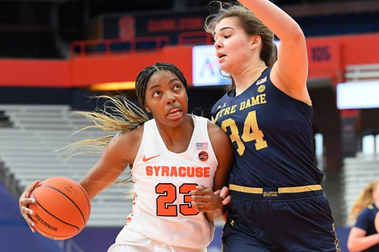 Jan 31, 2021; Syracuse, New York, USA; /s23 drives to the basket against the defense of Notre Dame Fighting Irish forward Madelyn Westbeld (34) during the first half at the Carrier Dome. Mandatory Credit: Rich Barnes-USA TODAY Sports