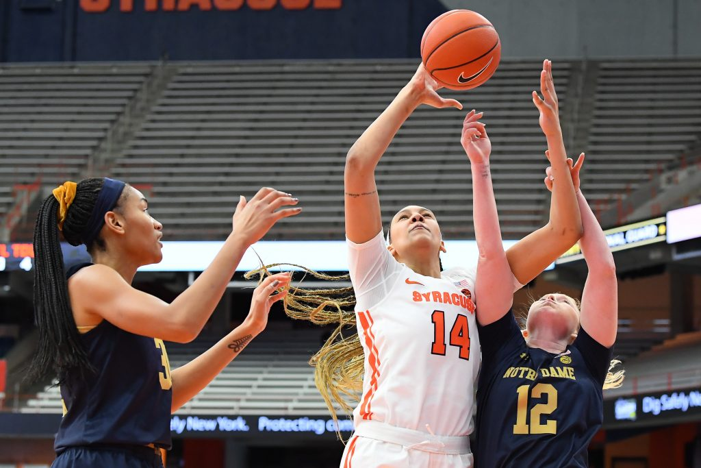 Jan 31, 2021; Syracuse, New York, USA; Syracuse Orange center Kamilla Cardoso (14) and Notre Dame Fighting Irish guard Abby Prohaska (12) battle for the ball during the first half at the Carrier Dome. Mandatory Credit: Rich Barnes-USA TODAY Sports