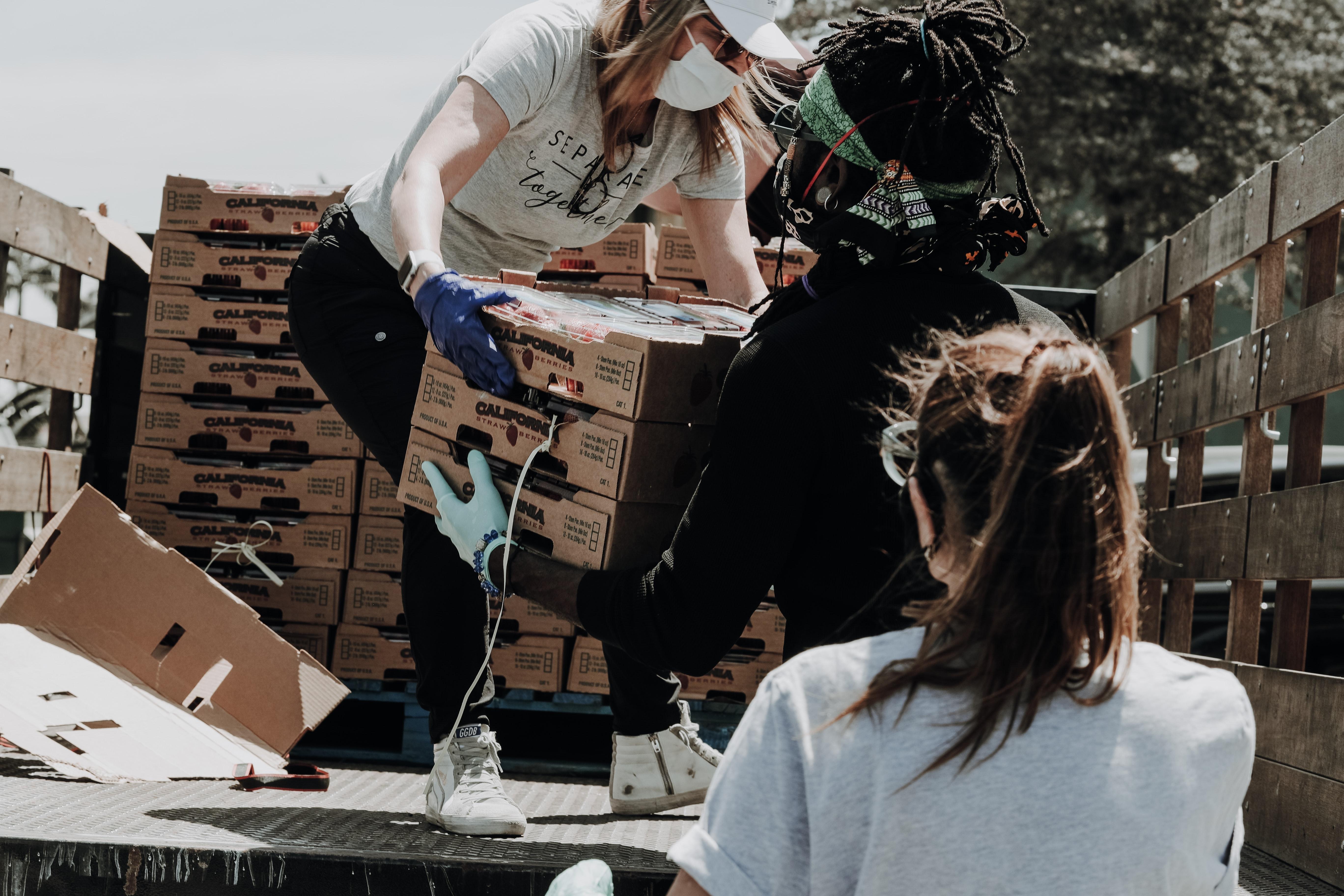 Volunteers helping unload a truck.