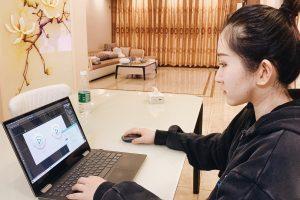Rebecca Jin at laptop