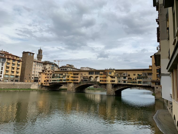 A famous Florentine bridge, the Vecchio, crosses the Arno river running through the city.
