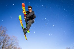 Mikey MacKnight grabs his ski as he airs of the last jump at Labrador Mountain in Truxon, New York. Mikey grew up skiing in the Syracuse, New York area and is one of the better local riders.