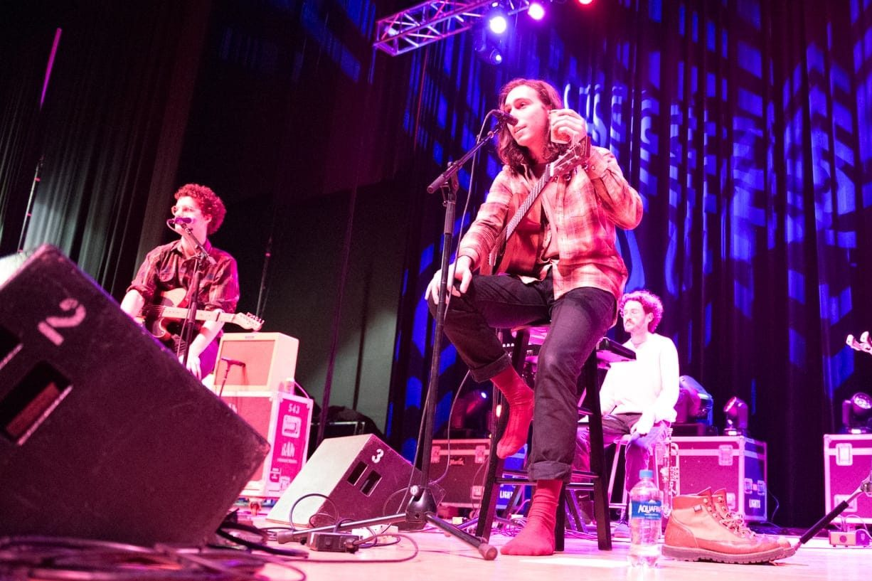 Whitney talking to the crowd at the Bandersnatch show in Goldstein Auditorium. Photo by Rachel Kline
