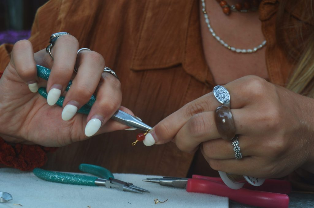 Lilyan Minicozzi works on a piece of jewelry with sustainable materials.