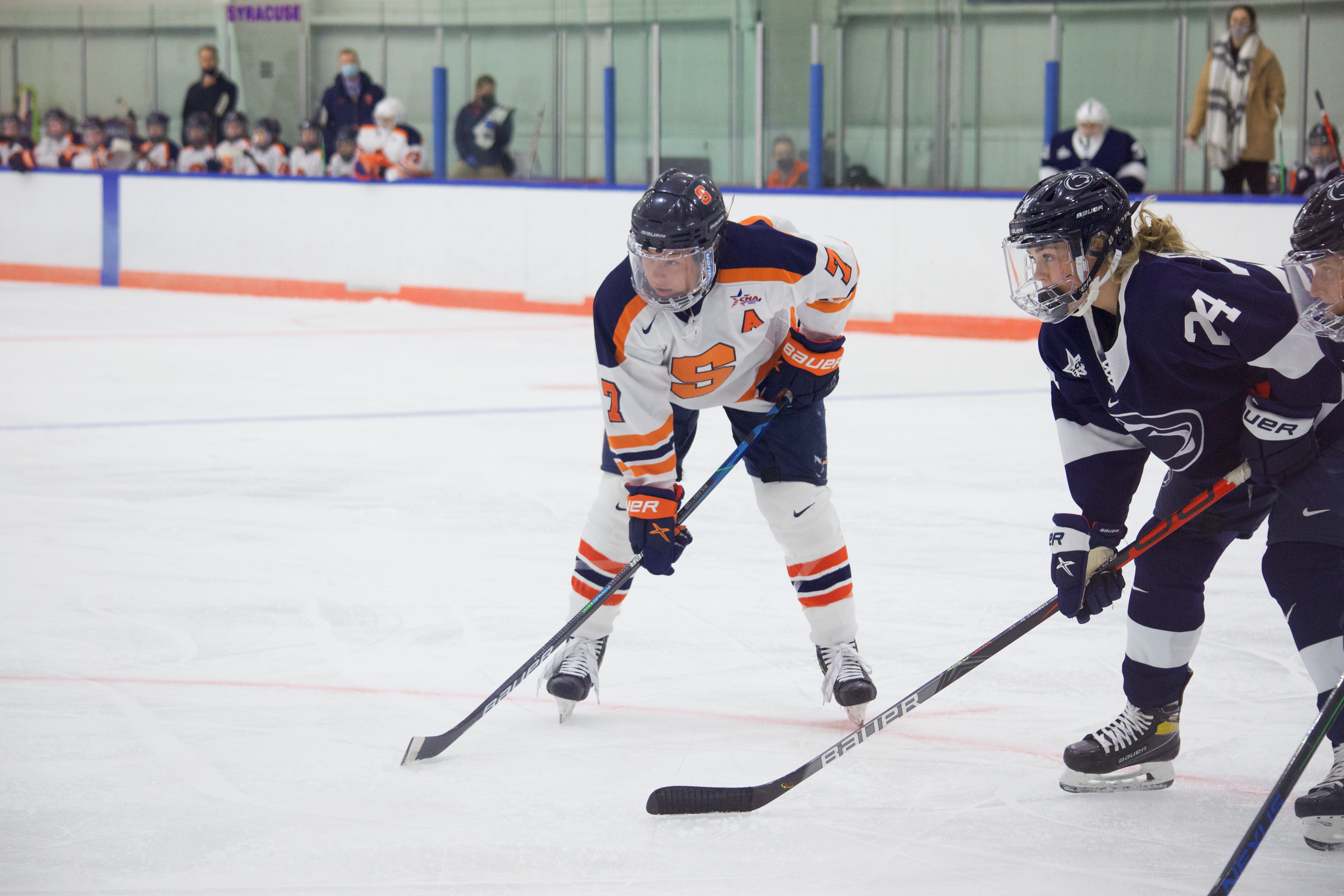 Syracuse senior assistant captain Emma Polaski lines up for an offensive zone face off during the Orange's game against Penn State on Dec. 12, 2020.