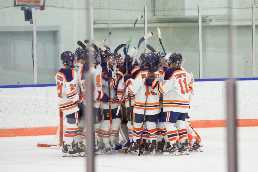 The Syracuse women's ice hockey team celebrates their 4-2 victory over Penn State on Dec. 12, 2020.