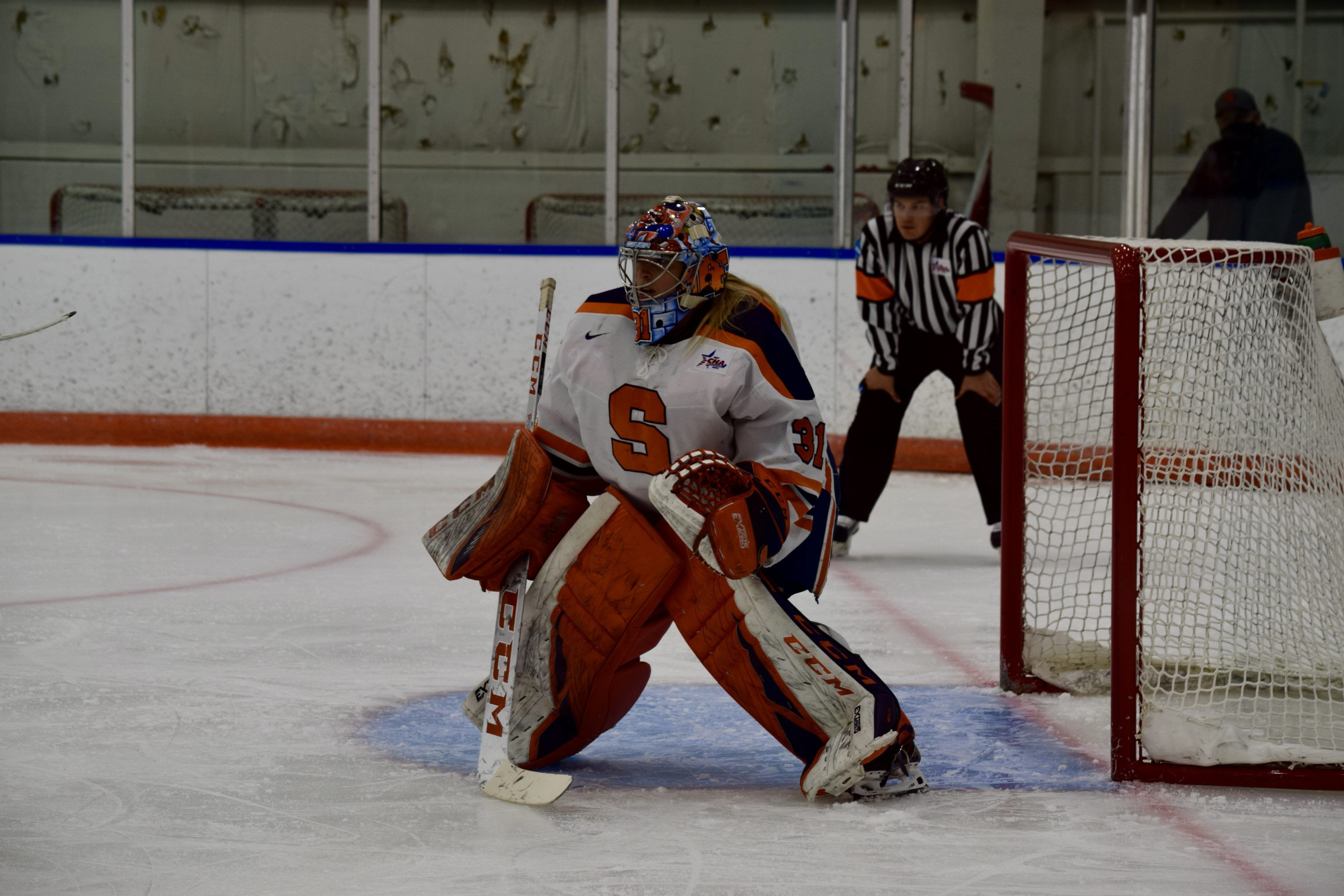 Syracuse goaltender prepares to defend the Orange goal before the faceoff during a game against Penn State on Dec. 11, 2020 at Tennity Ice Pavillion.