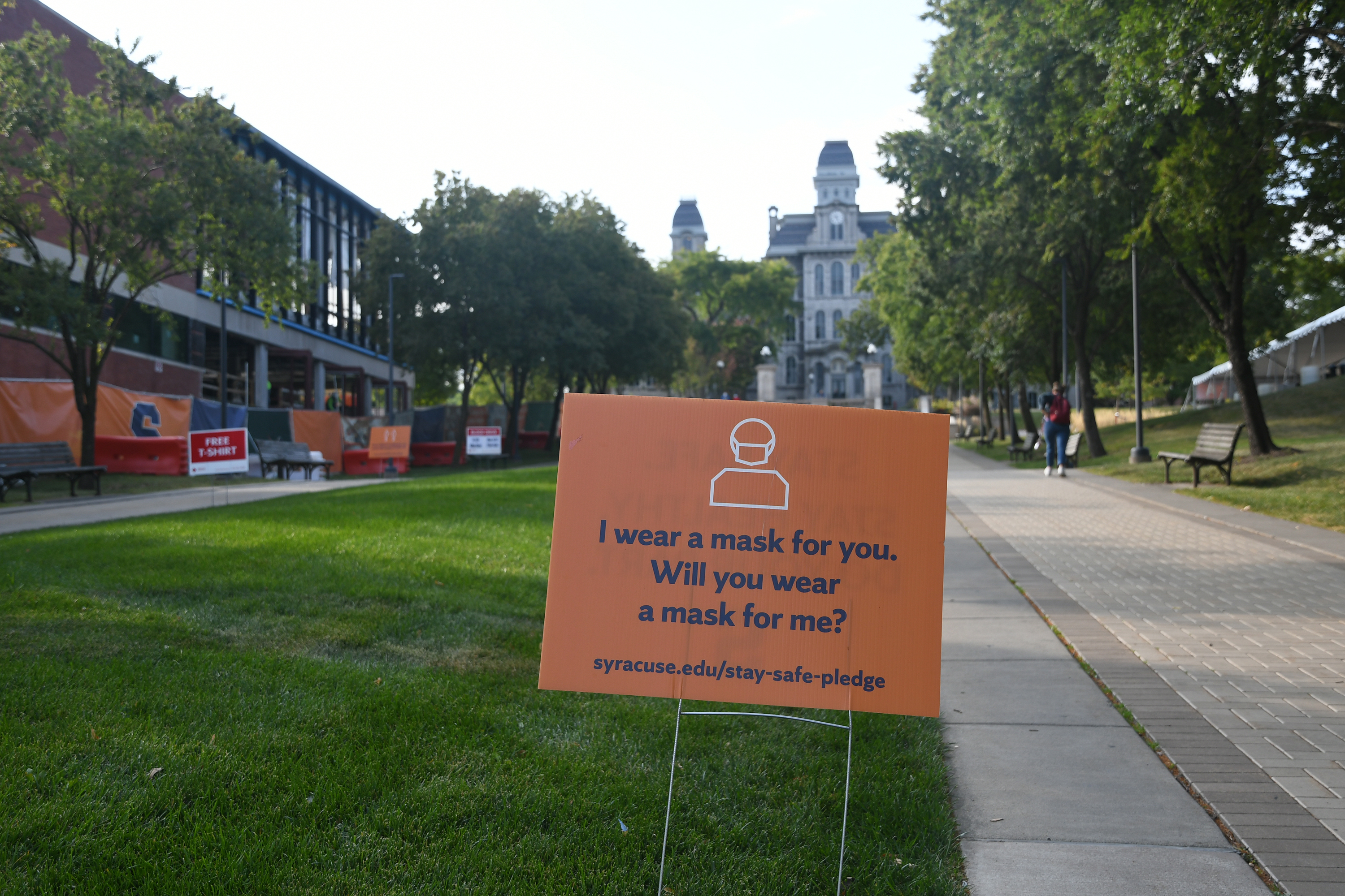 Signs reminding students to wear a mask on campus can be found around Syracuse University.