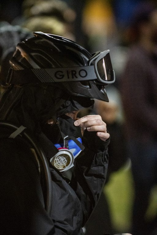 A protestor fixing their gear during a Black Lives Matter protest in Rochester, NY. This movement started from a video of Daniel Prude who died in police custody. After almost three weeks of protesting, many of the demonstrators had stopped attending the rallies. Those who did showed extreme fatigue.