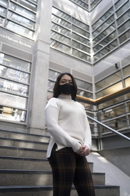 Morgan Storino stands in the Maxwell School of Citizenship and Public Affairs where she is one of the only Asian students in her Citizenship and Civic Engagement classes.
