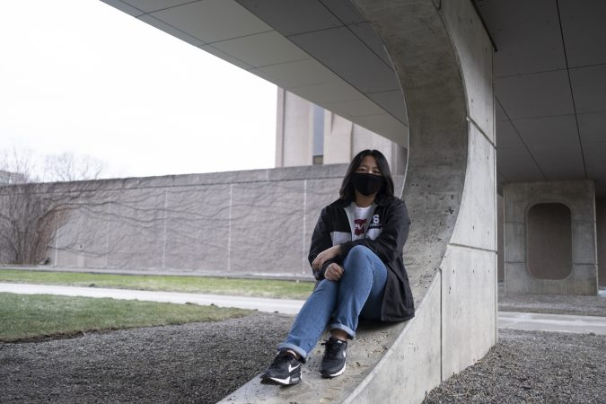 Despite other people assuming she studies STEM because of her race, Young Bin Lee sits in front of Newhouse where she majors in photography.
