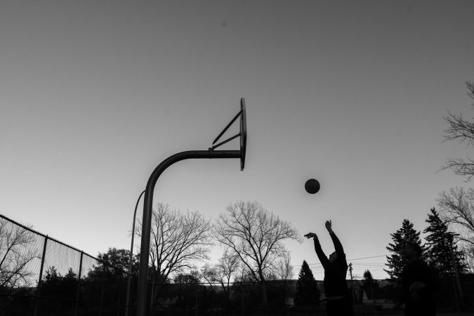 At the start of the pandemic, the city of Syracuse removed all of the rims from public basketball hoops and restricted hours of local green spaces.