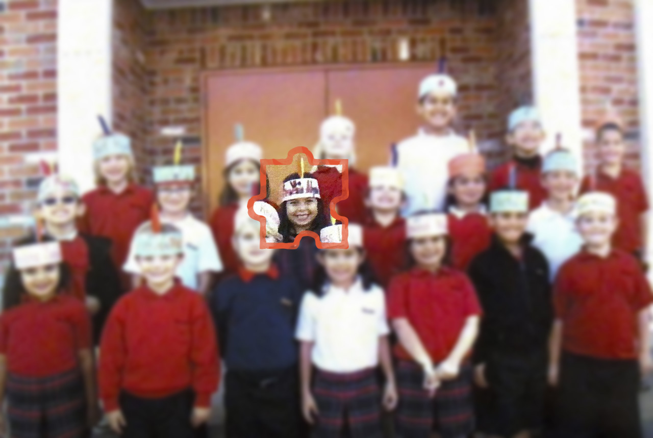Alycia Cypress (middle) and her elementary school classmates wearing feather headbands in order to pose as Native Americans for an annual Thanksgiving lunch.