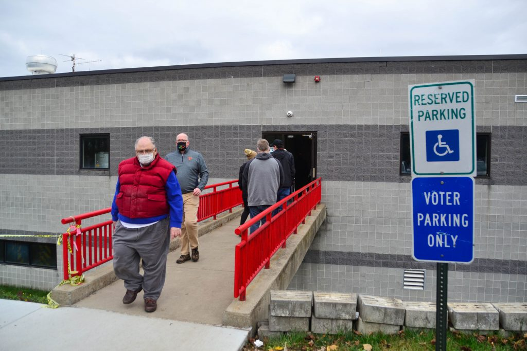 Voters leave the Camillus Fire Station on Oct. 31, 2020 after casting their ballots.