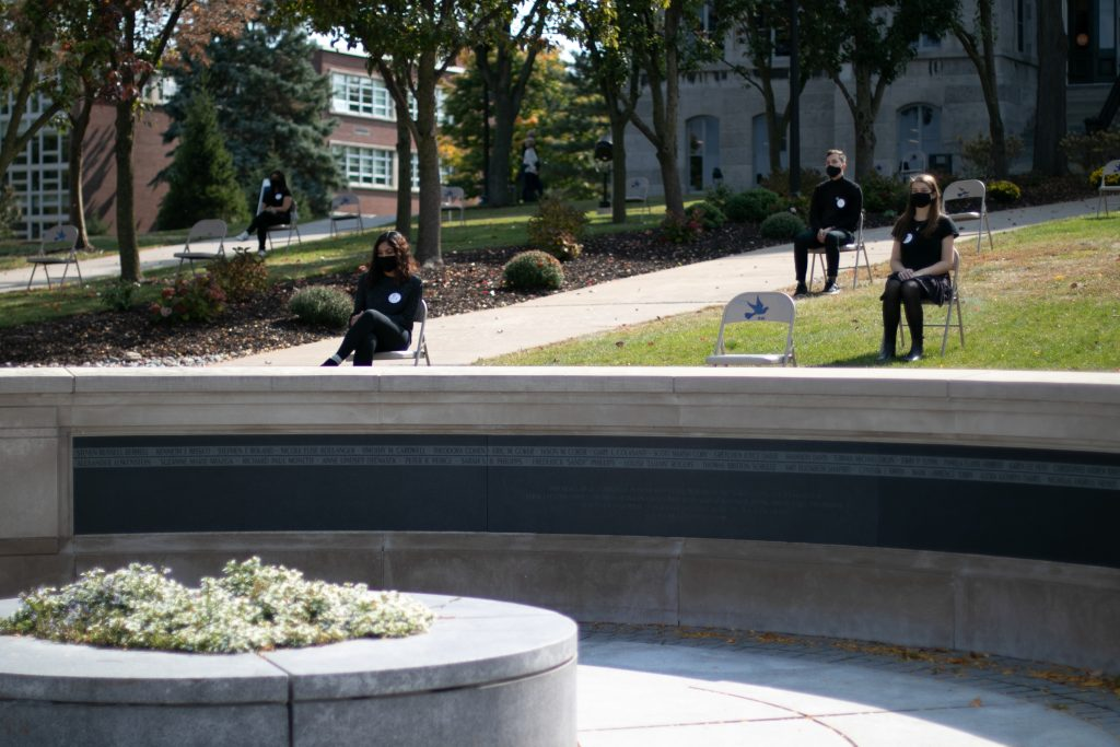 The 2020 Remembrance Scholars sit in front of SU's Hall of Languages from 1:25 pm to 2:01 pm to symbolize the time of flight for Pan Am Flight 103.