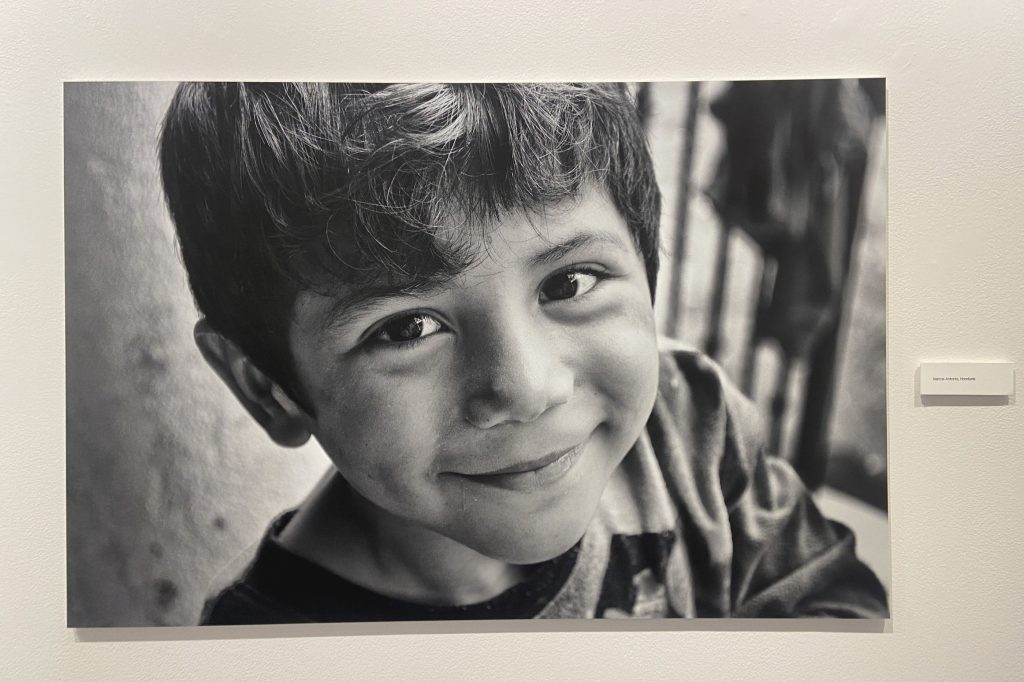 close-up of a boy shot from above grinning at the camera