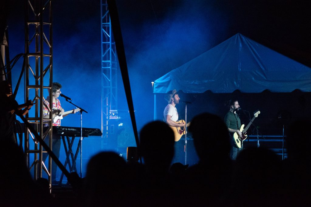 Performing at the New York State Fair, the name of the band, AJR, represents the three brothers' names: Adam, Jack, and Ryan.