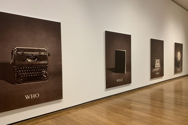 """Carrie Mae Weems' original series titled """"Who What When Where"""" photos of a typewirighter, a book, a clock, and a globe."""