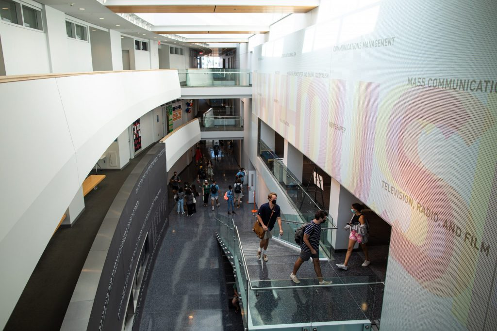 Students walk to their in-person classes in Newhouse 3 on Monday.