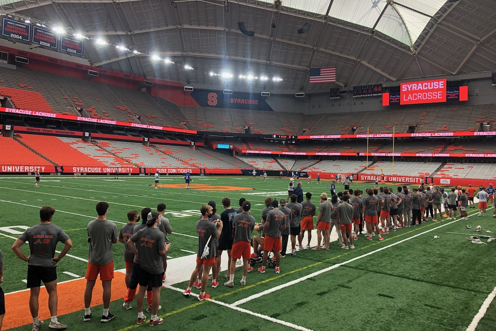 The 2022 Syracuse men's lacrosse team watches Orange alumni play in a friendly game on Saturday in the Dome.