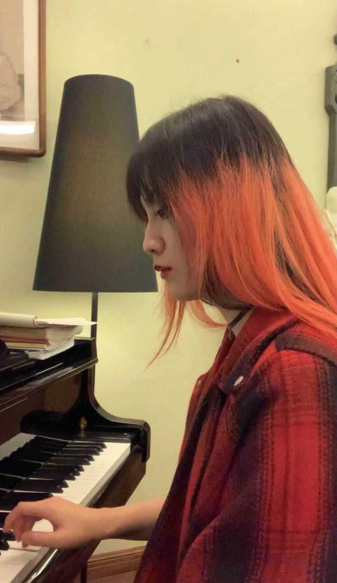 Ash Ji playing piano