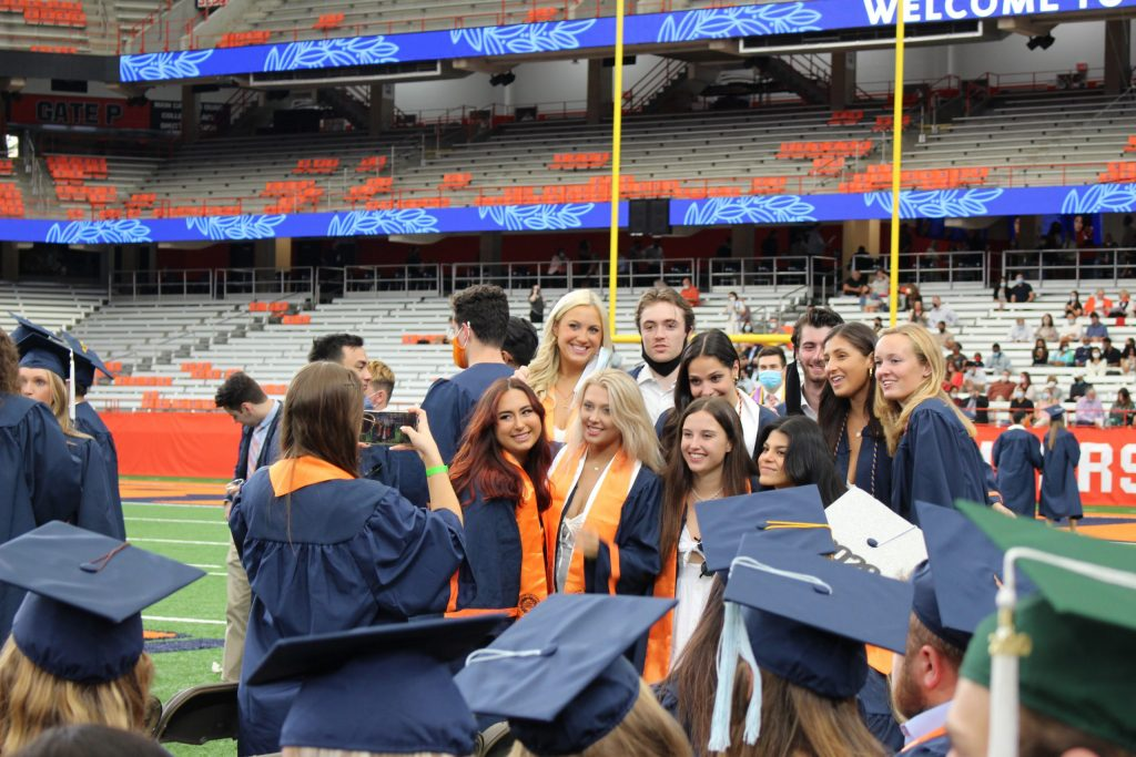 2020 SU graduates pose before the September 19, 2021 Commencement ceremony in the Dome on September 19th, 2021.