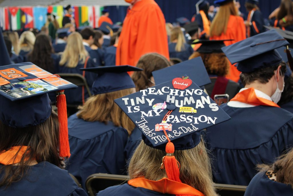 A 2020 SU graduate sits before the September 19, 2021 Commencement ceremony in the Dome on September 19th, 2021a.