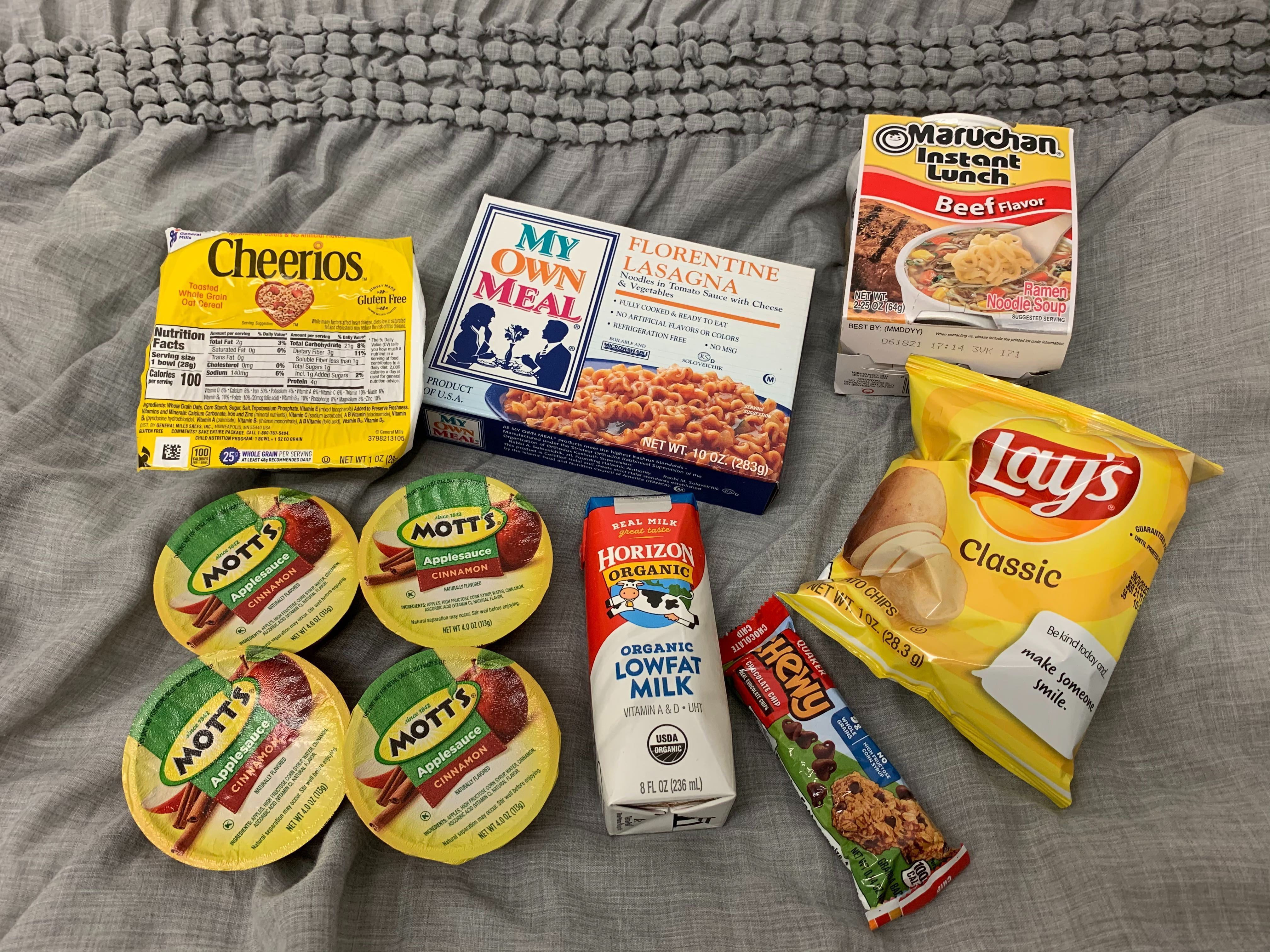 Meal provided to students including; Lays; ramen; apple sauce; milk; a granola bar; and a microwavable meal