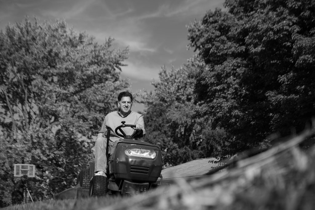 October 11th, 2020. Joseph Pagano mows his lawn and his neighbor's lawn on his lawn mower. He doesn't see the activiy as a chore and appreciates the labor.