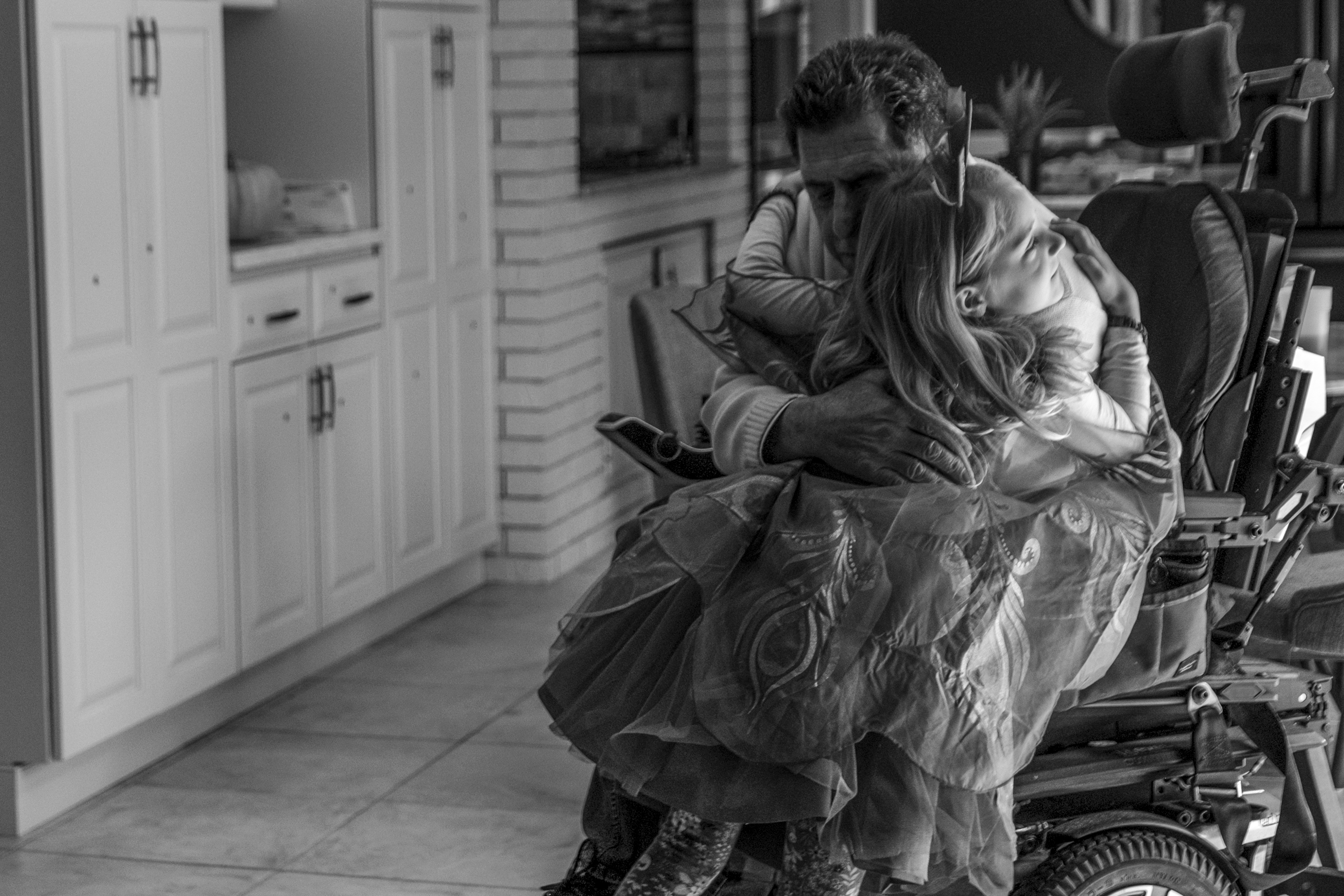 October 18th, 2020. Joseph Pagano's granddaughter hugs him after tiring herself out being a peacock and showing off her feathers.