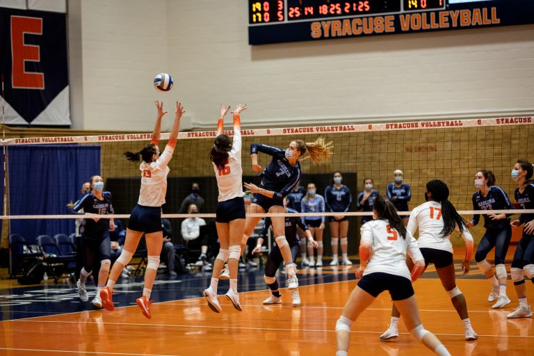SU's Yuliia Yastrub (13) and Abby Casiano (16) block a spike during the March 5, 2021 game against UNC in the Women's Building in Syracuse, NY.
