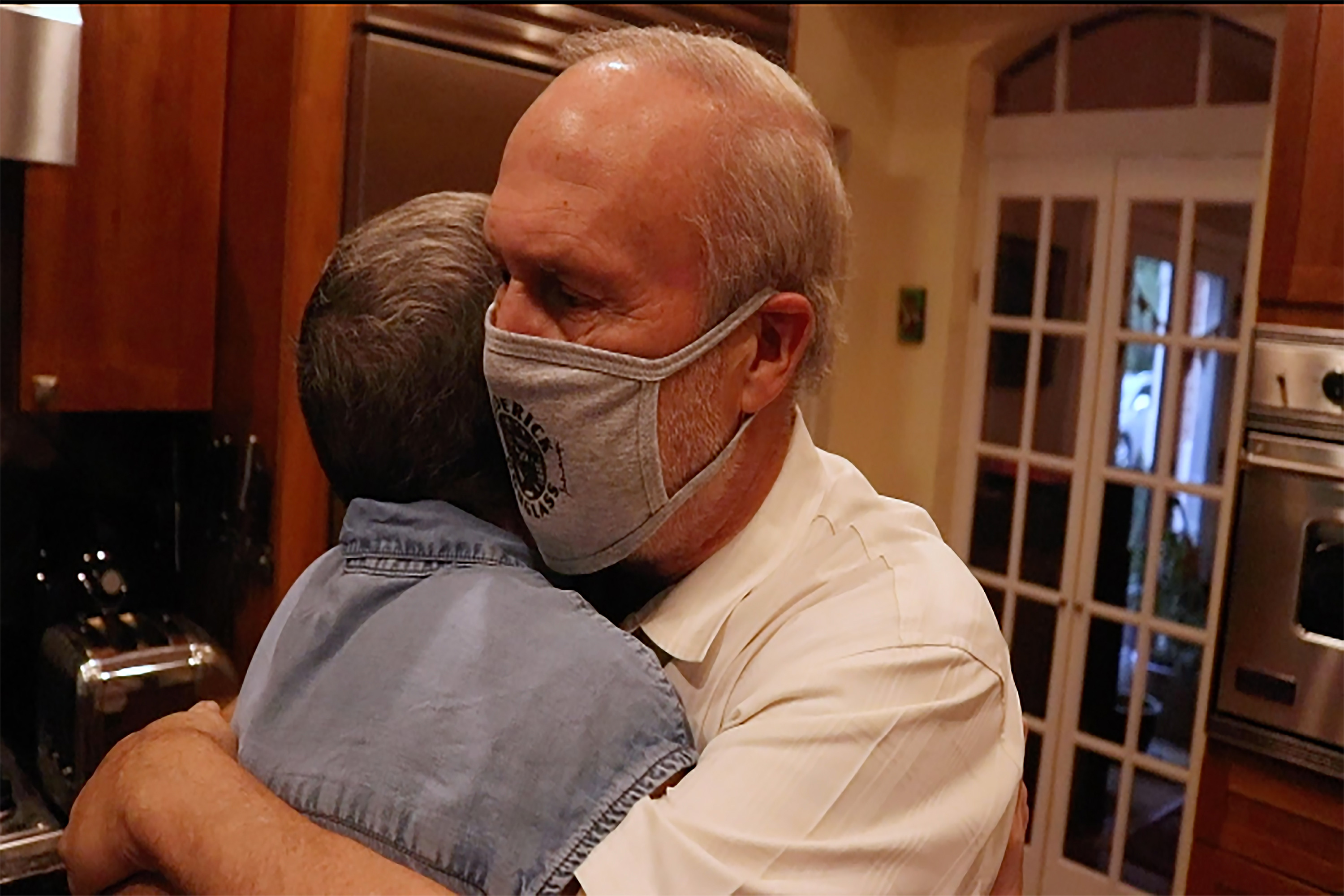Michele Miller and Jeff Miller' embrace in their Arizona home in fall 2020 as Michele is in remission from ovarian cancer.