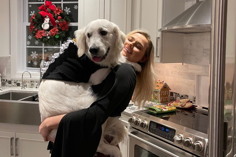 SU sophomore Mandy Good holds her dog, Bentley, who she adopted in May 2020.