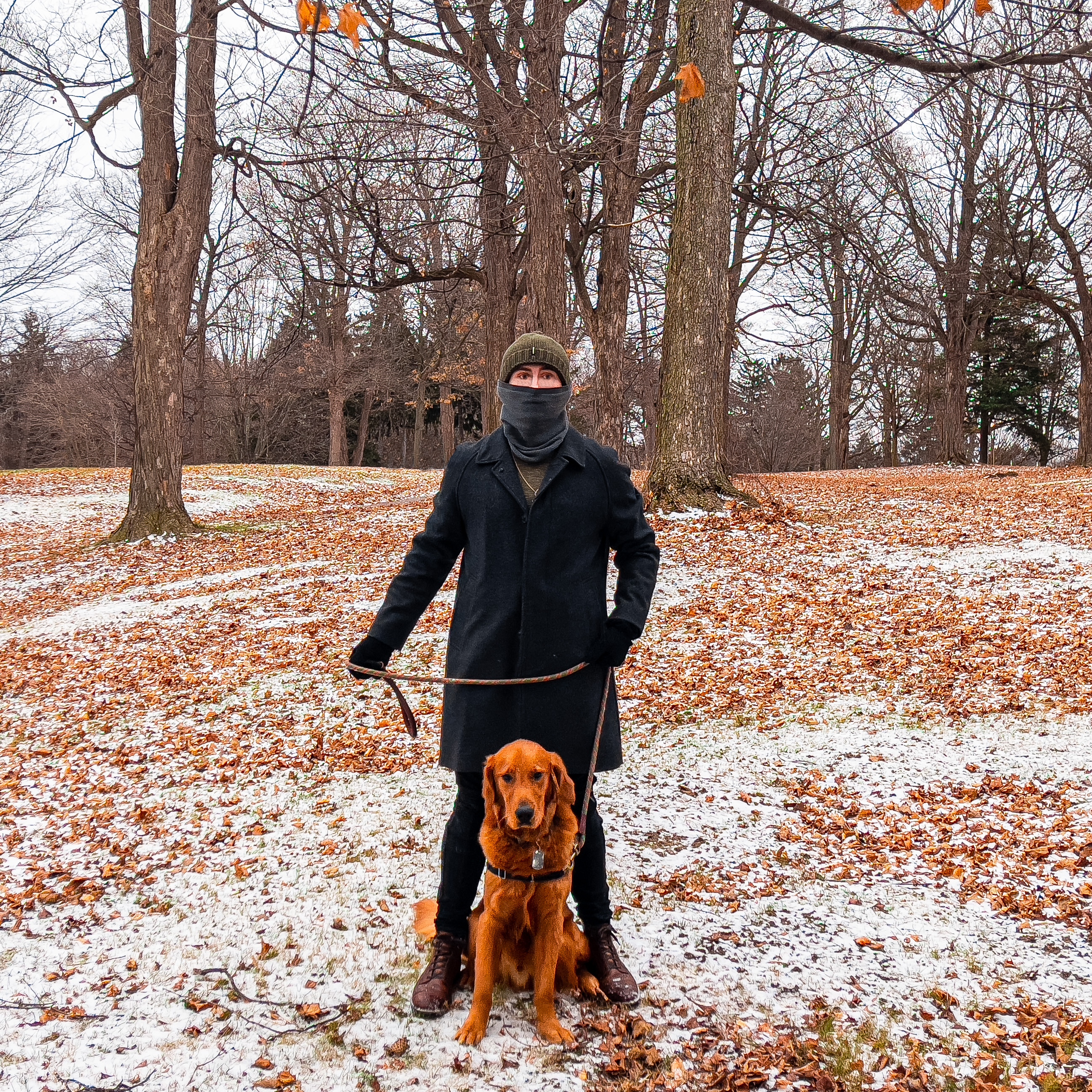 Ryan Yon, SU sophomore and army veteran, poses for a photo with his American golden retriever, Gunner, on a snowy day.