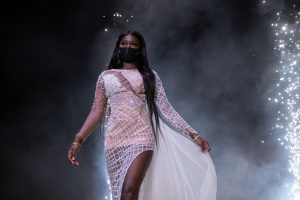 A student model walks the runway at the Syracuse University African Student Union Fashion Show.