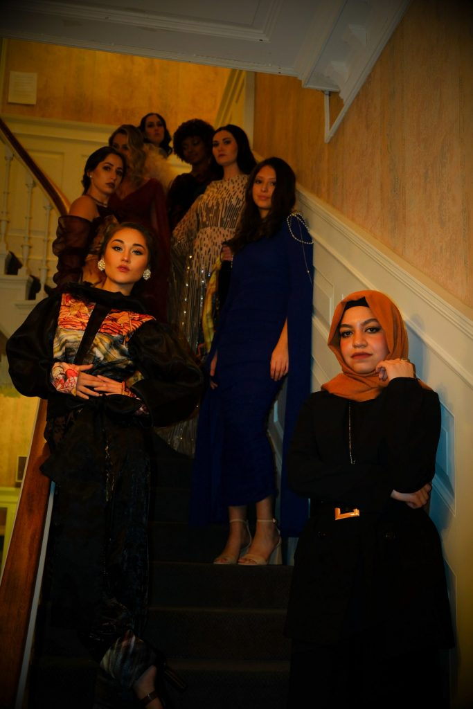 Kal and her models pose for a portrait during the second event of Syracuse Fashion Week.