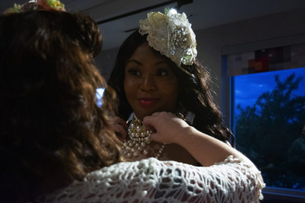 A model gets ready backstage prior to the show on Thursday night.