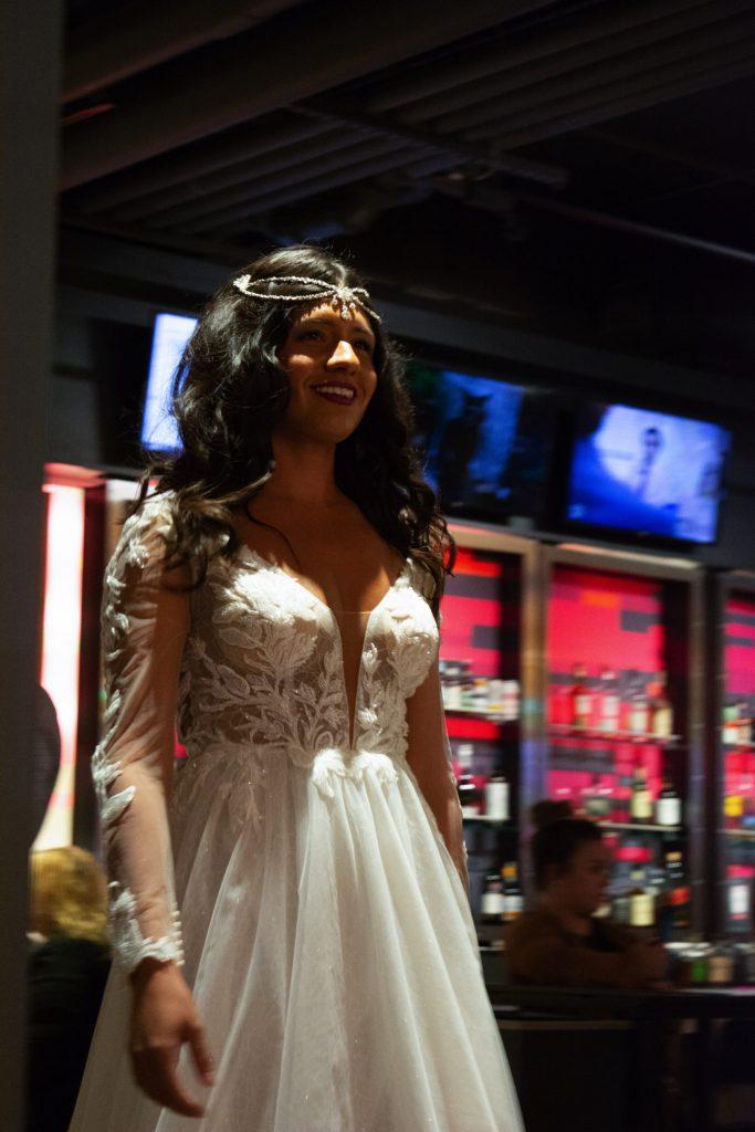 A model walks down the runway at Syracuse Fashion Week.