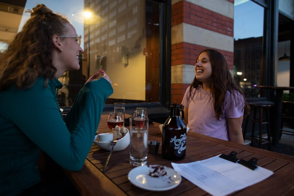 Natalie Wiesnet Shelton (Left) and Jessica Jarett (Right) enjoy a drink and a meal at Anything But Beer on September 10th, 2021. (Photo by Ryan Griffith)