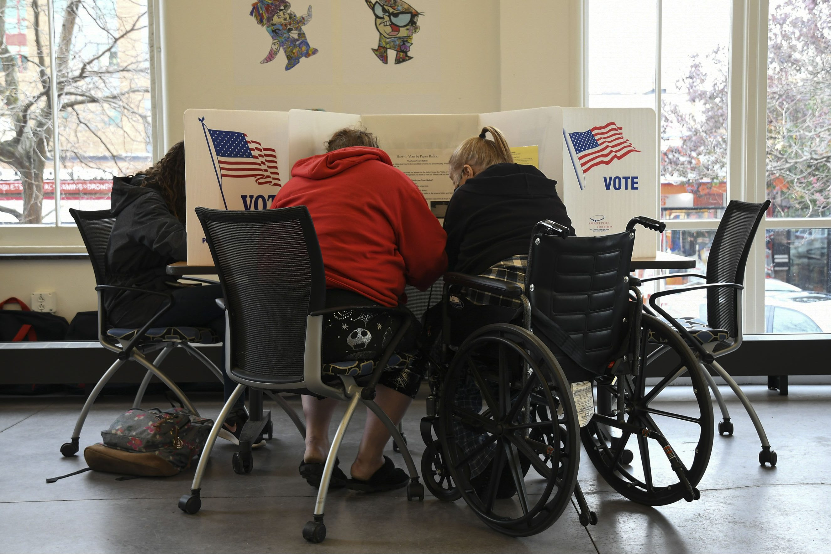 A voter with disablity receives accommodation in the voting process.