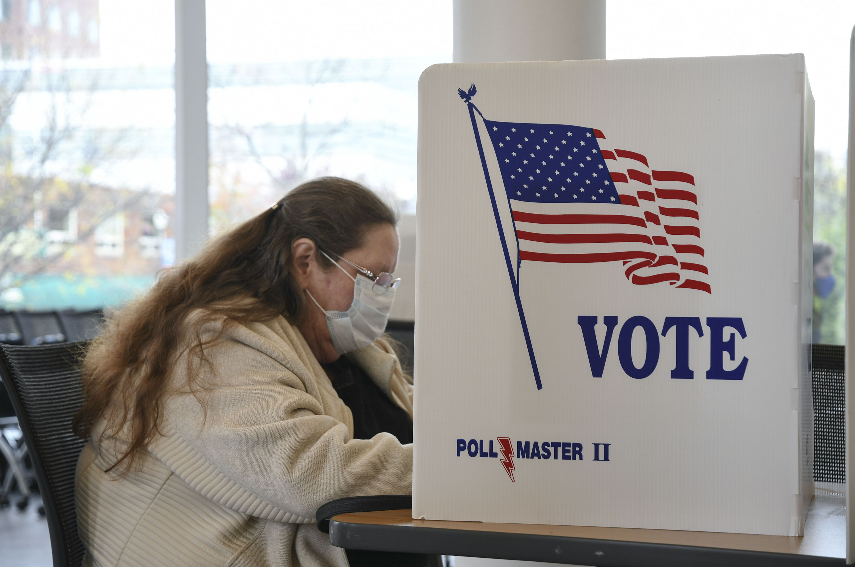 A voter at SU Huntington Hall polling station fills out her ballot.