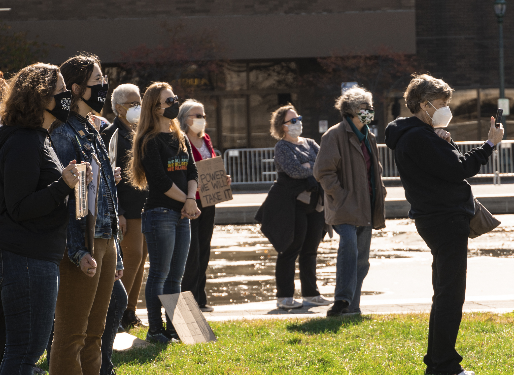 Protesters gathered on the lawn at Clinton Square Satruday afternoon. The event lasted around an hour and half. Masks and social distancing were required of attendees. (Photo by Patrick Linehan)