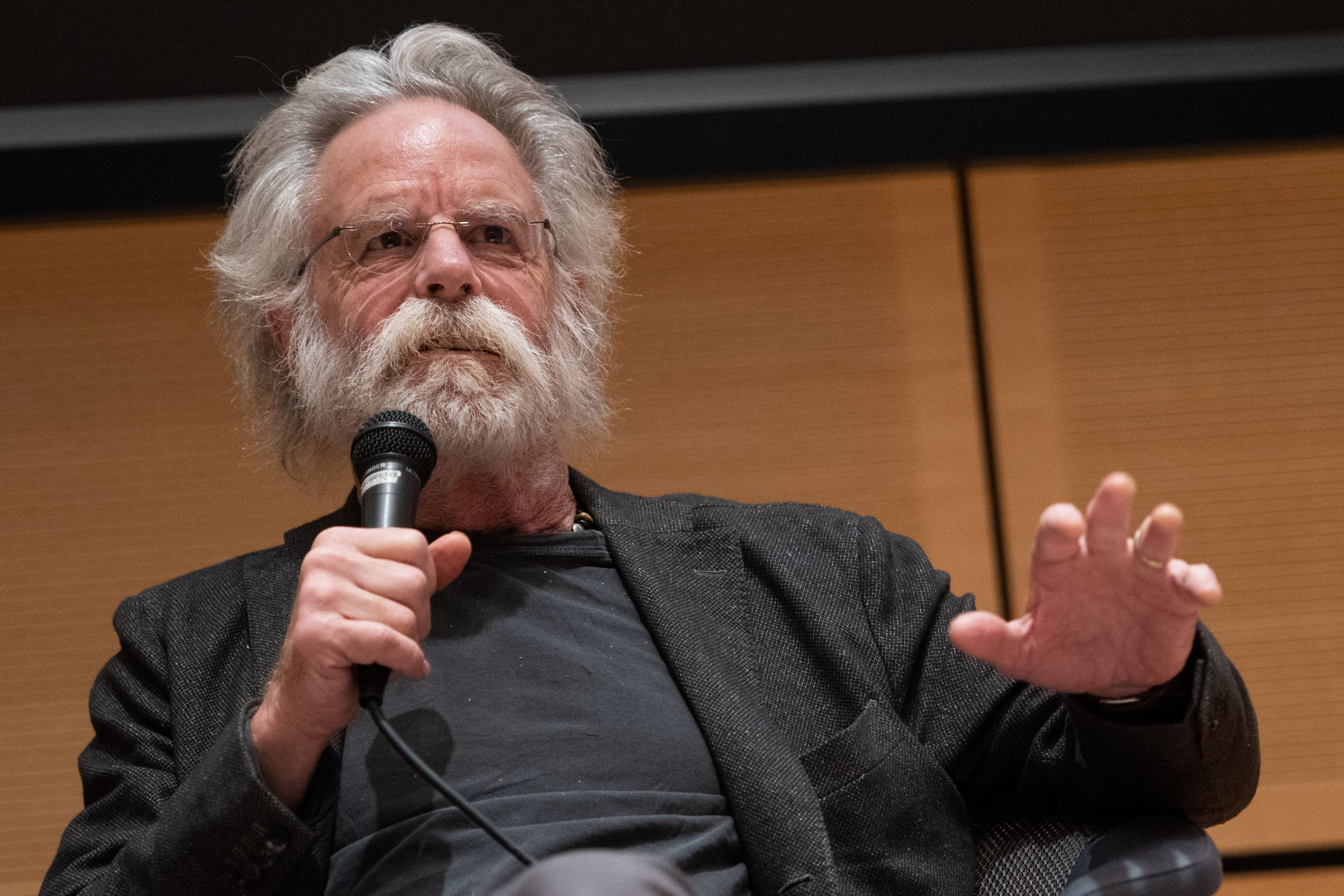 Founding member of the Grateful Dead, Bob Weir, speaks to a group of students and faculty at the Joyce Hergenhan Auditorium on Nov. 7, 2018.