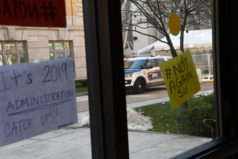 A Department of Public Safety car was parked near Barnes Center where the #NotAgainSU sit-in continued Tuesday.