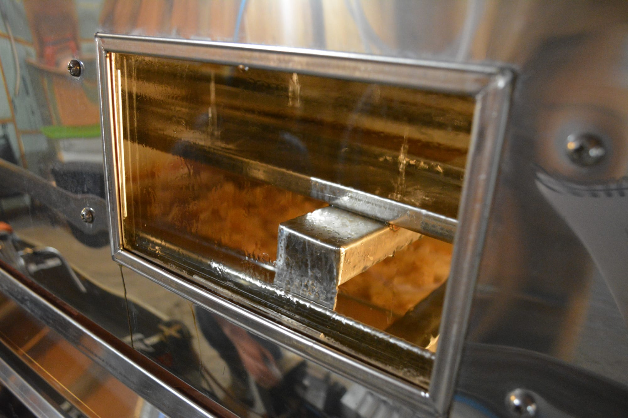 Inside the evaporator, a pan is filled with a layer of sap at least 1.5 inches deep and begins to boil. To be considered syrup — sap with a sugar content of 66 to 67 percent — the sap is heated about 7 degrees above the boiling point, which is roughly 219 degrees.
