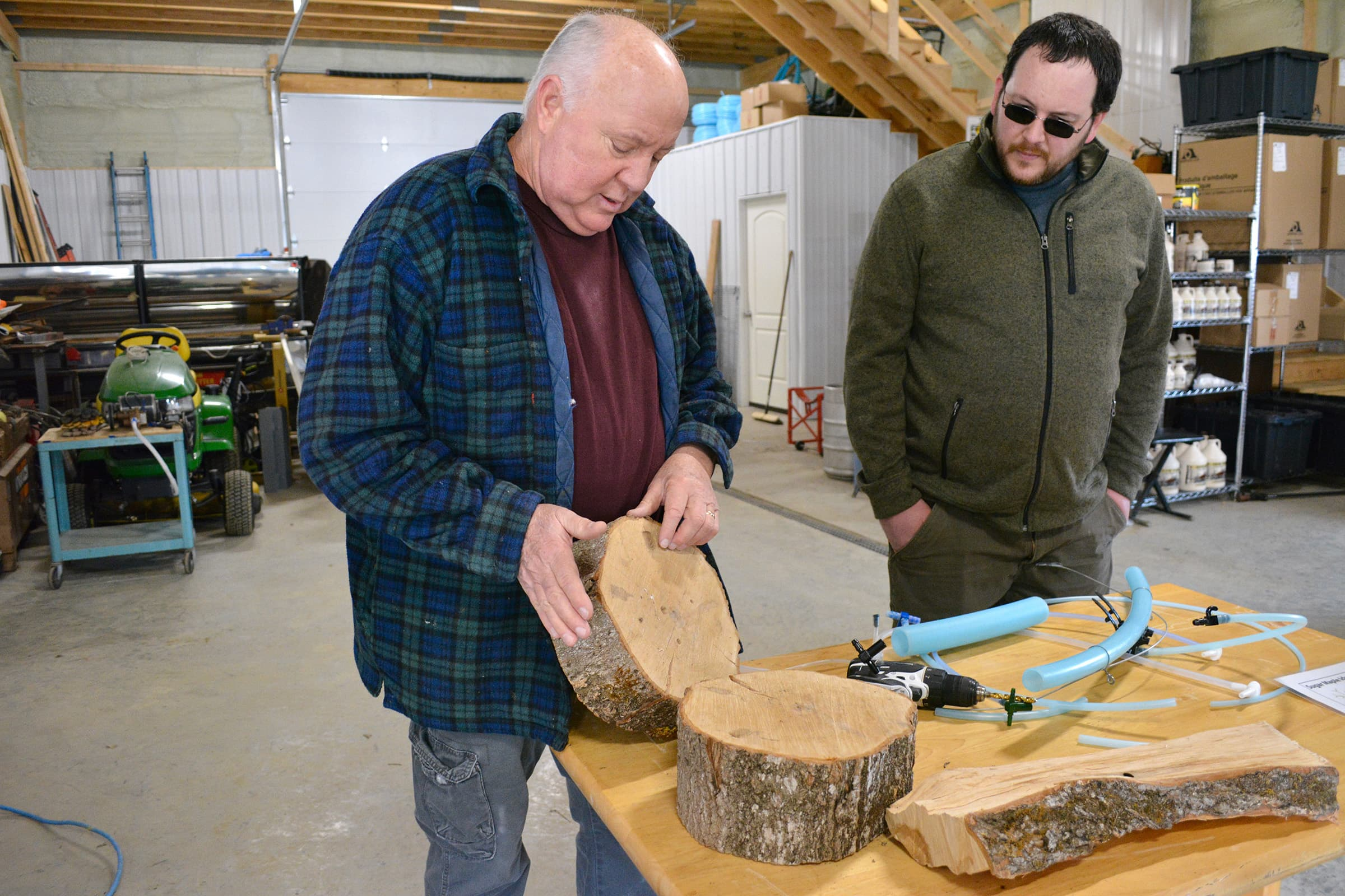 Dan Beasley shows Maple Weekend visitors how a maple tree responds to being tapped.