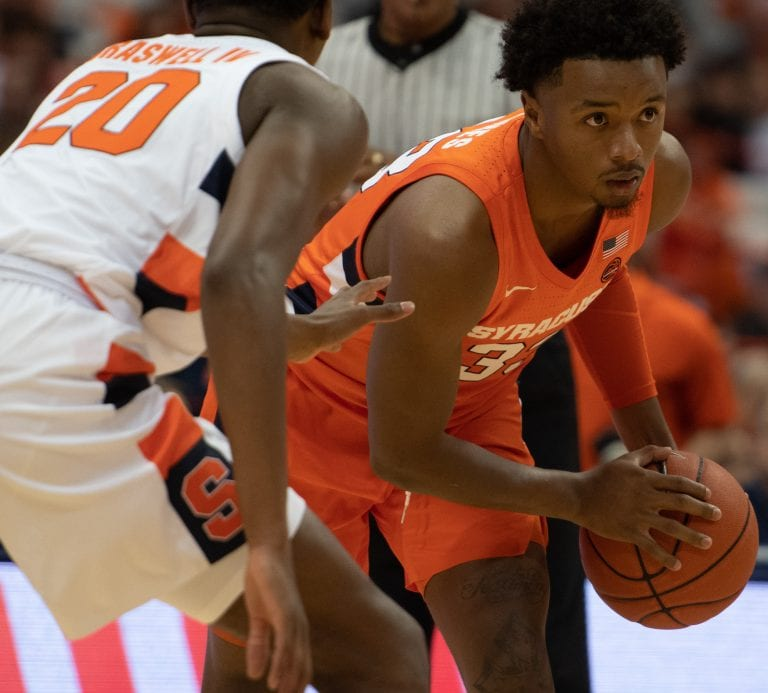 Robert Braswell (20) and Elijah Hughes (33) during the Orange and White scrimmage at the Carrier Dome on Oct. 11.